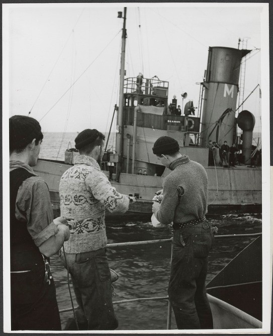 Pigeon being passed from British tug to Canadian corvette.